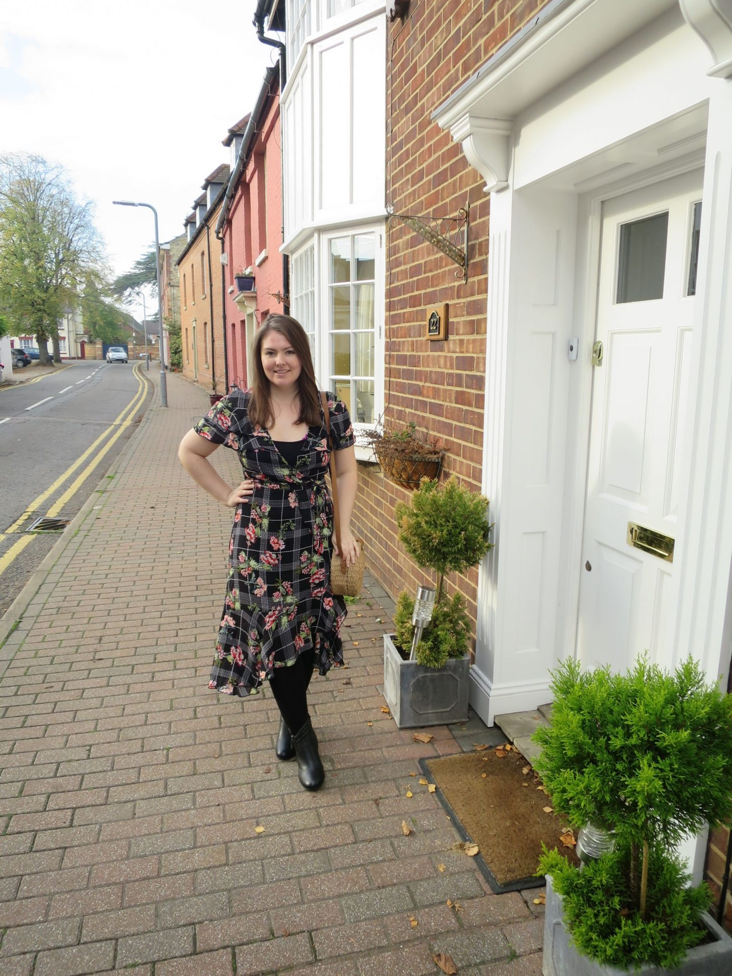 Wearing a floral and check Boohoo dress on a street in Stony Stratford